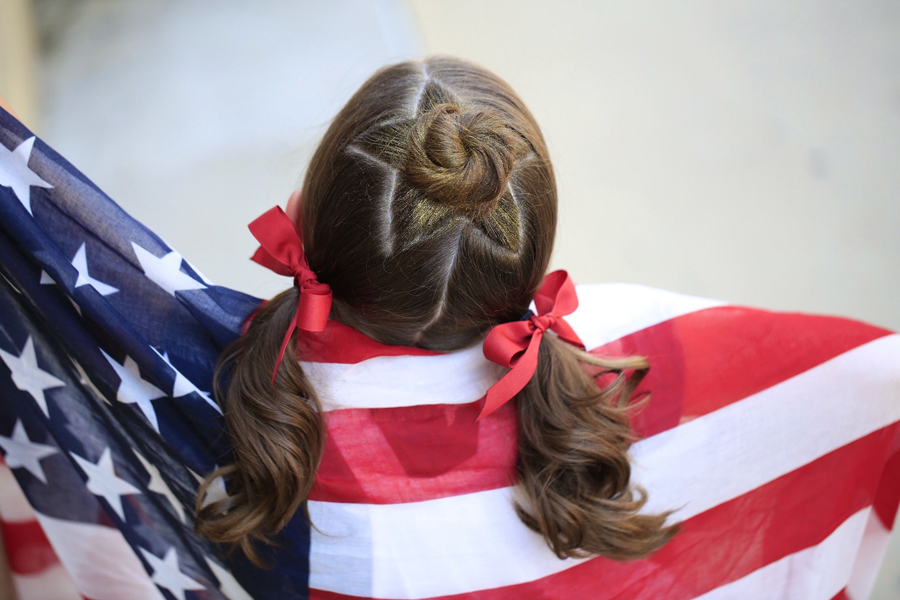 patriotic girl in flag